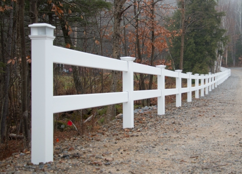 Vinyl posts accented with solar caps for driveway entry