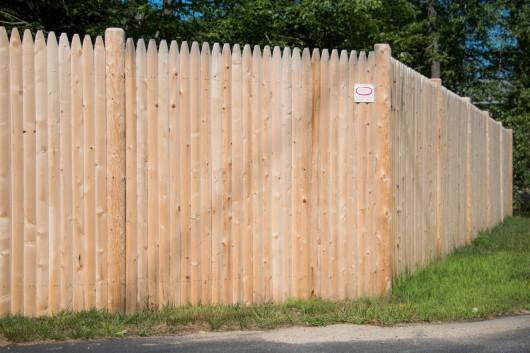 Premium cedar stockade fence set on round posts