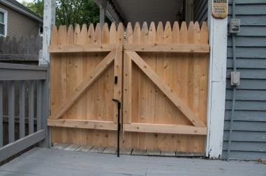 Custom stockade porch gate installation
